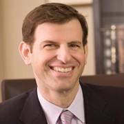 Dr Adam Kolker